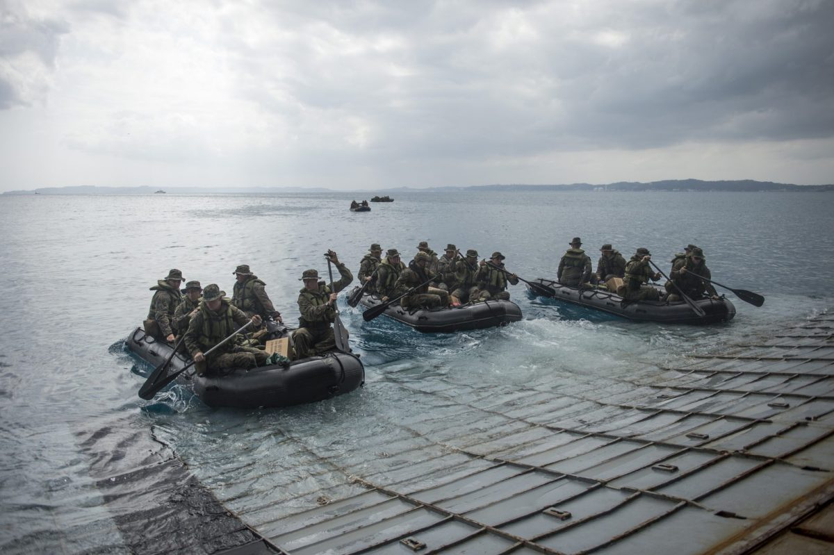 140306-N-ZU025-204OKINAWA, Japan (March 6, 2014) Marines assigned to Company F, Battalion Landing Team, 2nd Battalion, 5th Marines, 31st Marine Expeditionary Unit (31st MEU) conduct launch and recovery operations with combat rubber raiding craft from the well deck of the amphibious transport dock ship USS Denver (LPD 9). Denver is assigned to the Bonhomme Richard Amphibious Ready Group and is conducting operations in the U.S. 7th Fleet area of responsibility. (U.S. Navy photo by Mass Communication Specialist 3rd Class Todd C. Behrman/Released)