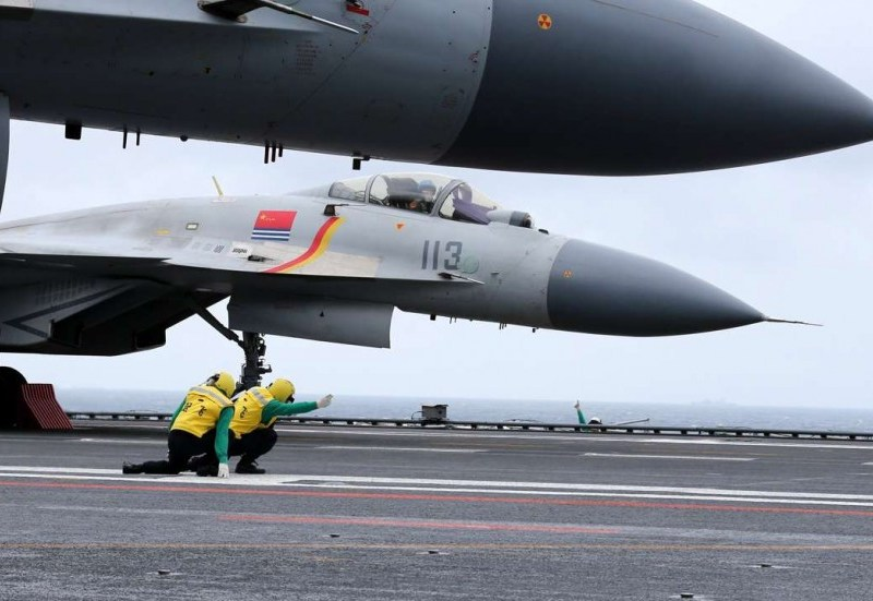 A J-15 jet fighter prepares to take off from the deck of the Liaoning, China's first aircraft carrier, during a drill in the South China Sea on Monday. Photo via SCMP.