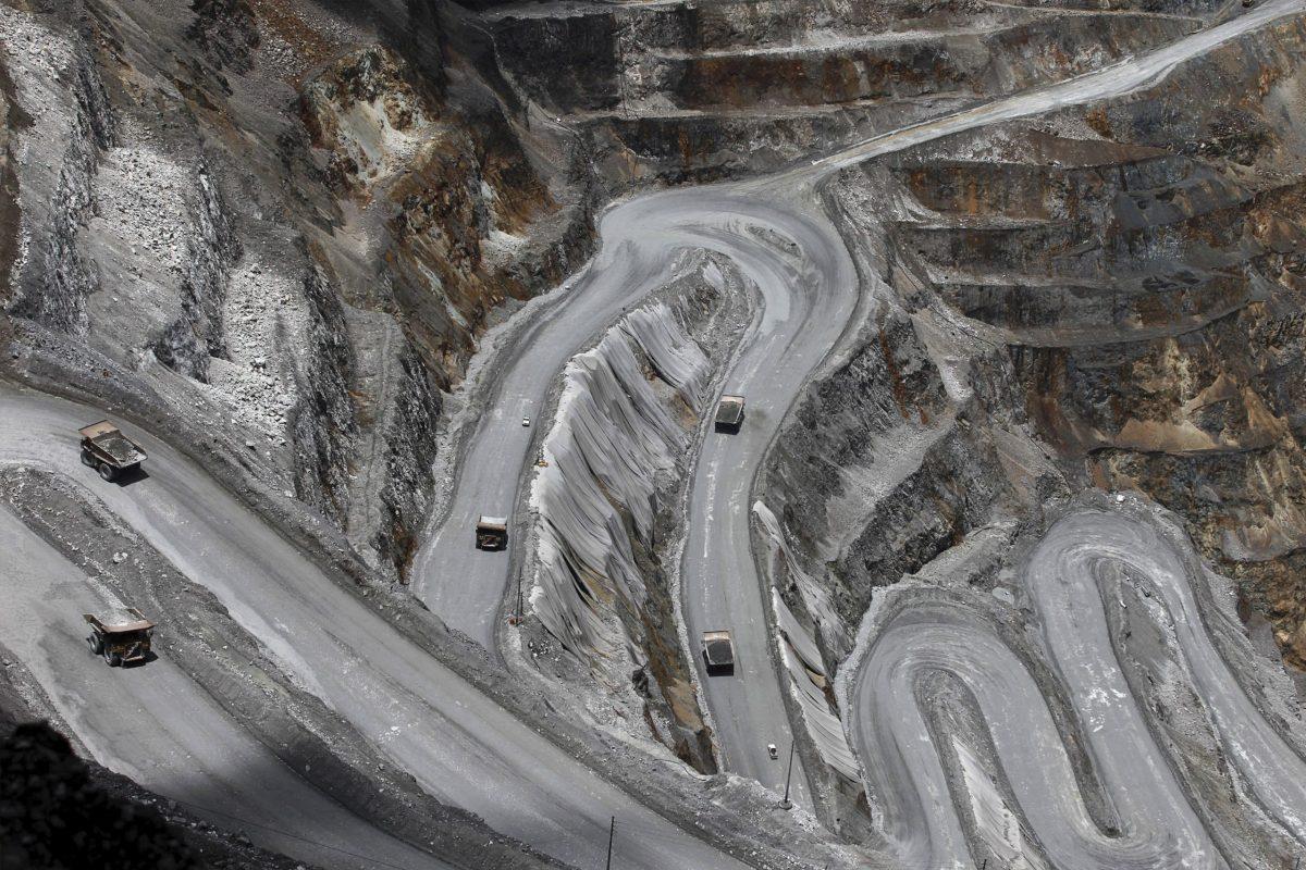 Trucks in the open-pit mine of PT Freeport's Grasberg copper and gold mine in the eastern region of Papua, Indonesia, September 19, 2015. Antara Foto/Muhammad Adimaja