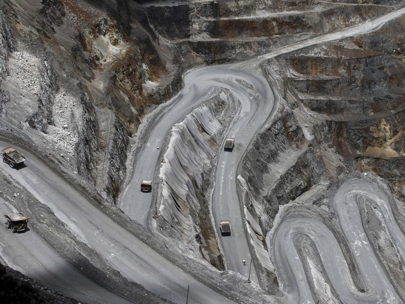 Trucks in the open-pit mine of PT Freeport's Grasberg copper and gold mine in the eastern region of Papua, Indonesia, September 19, 2015. Antara Foto/Muhammad Adimaja
