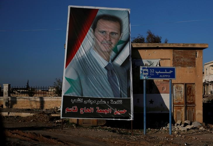 A picture of Syria's President Bashar al-Assad is seen in Ramouseh, a government controlled area of Aleppo, Syria December 8, 2016.   REUTERS/Omar Sanadiki