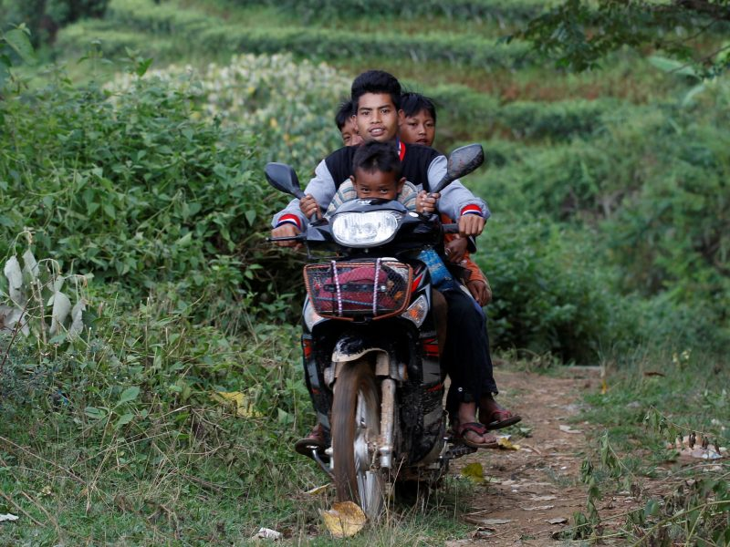 Road to reform: Youngsters on their motorbike as they travel outside Pansang, Wa territory. Photo: Reuters/Soe Zeya Tun