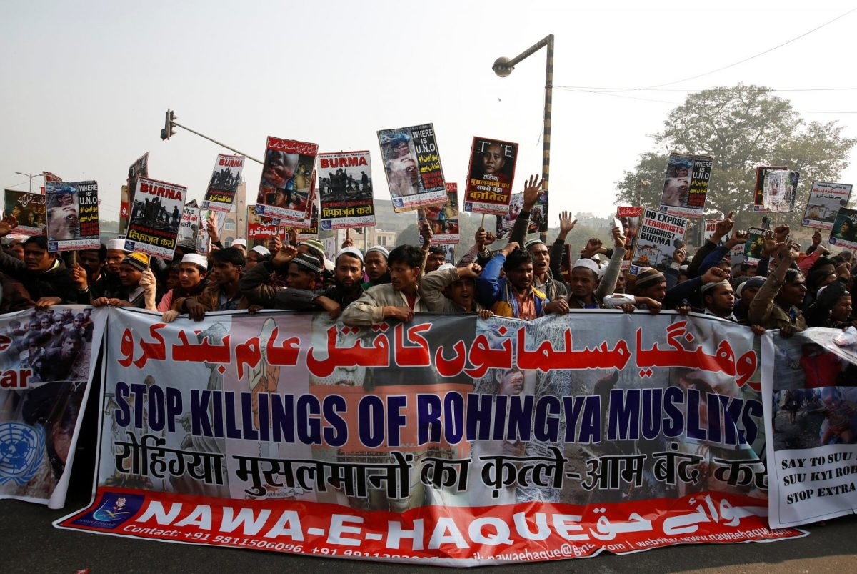 Rohingya Muslim refugees hold a banner and placards during a protest in New Delhi against a  crackdown on Rohingyas in Myanmar, in December 2016. Photo: Reuters/Adnan Abidi