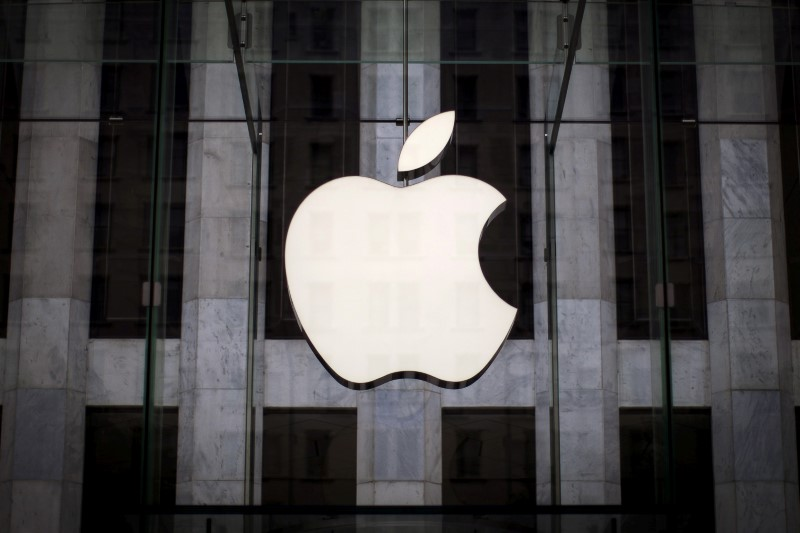 An Apple logo hangs above the entrance to the Apple store on 5th Avenue in the Manhattan borough of New York City, July 21, 2015. REUTERS/Mike Segar/File Photo