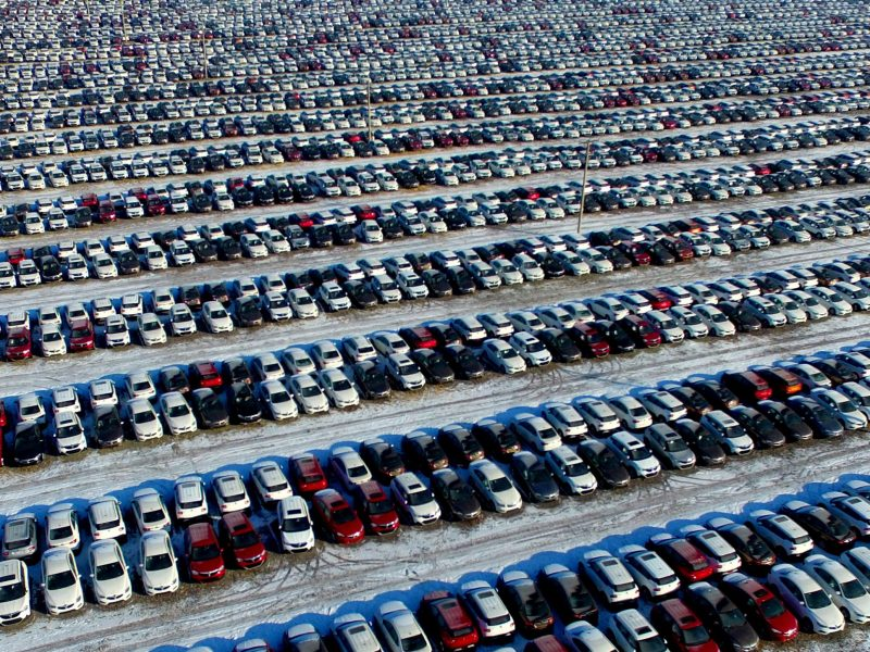 New cars are seen at a parking lot in Shenyang, China. Photo: China Daily via AFP