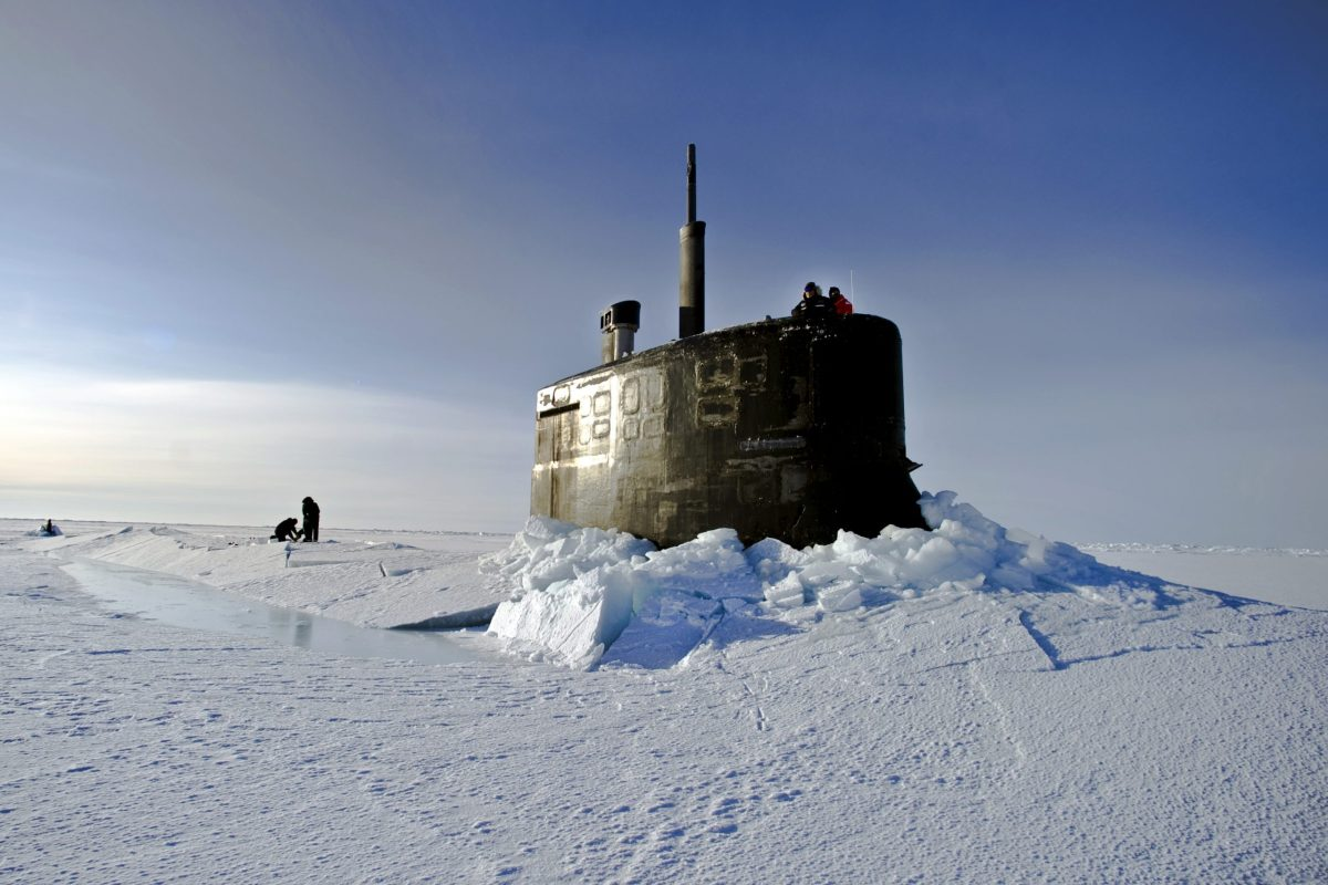 U.S. Navy sailors and members of the Applied Physics Laboratory Ice Station clear ice from the hatch of the USS Connecticut (SSN 22) as it surfaces in the Arctic Ocean on March 19, 2011.  Photo: Wikipedia Commons