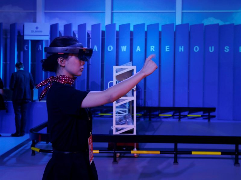 Empress's new clothes? An attendant demonstrates augmented reality shopping during Alibaba Group's 11.11 Singles' Day in 2016. Photo: Reuters/Bobby Yip