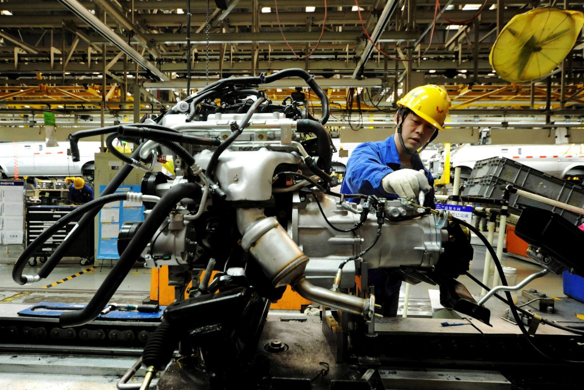 An employee works on an assembly line producing automobiles at a factory in Qingdao, Shandong Province. Photo: Reuters