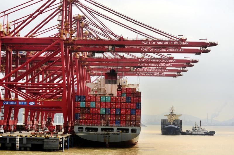 A ship loaded with containers at a port in Ningbo, China. Photo: Reuters