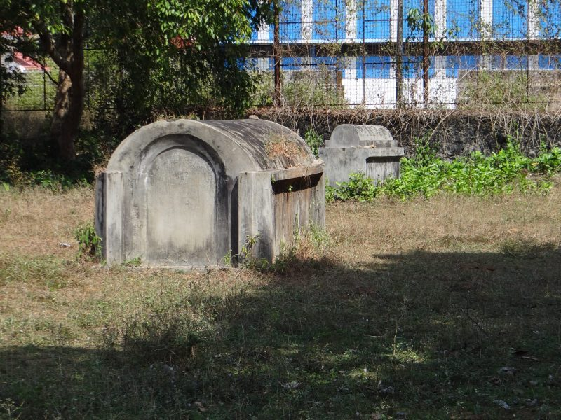 Of the 30-odd tombs, only three are left now. The low wall dividing the cemetery for construction purposes is seen behind. Photo: Asia Times
