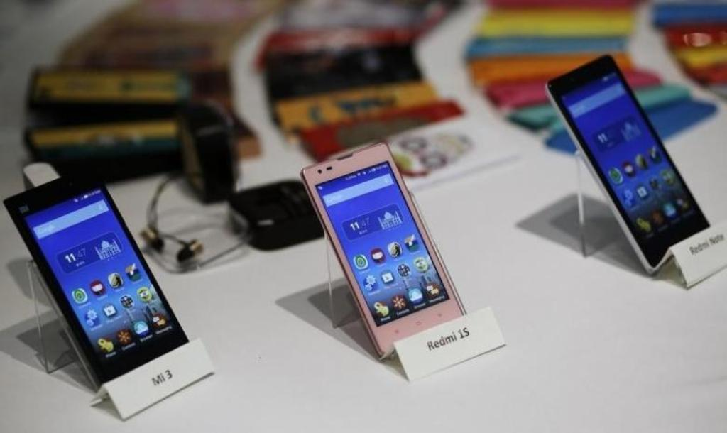 Three Xiaomi Mi models at a launch in New Delhi. Photo: Reuters / Anindito Mukherjee