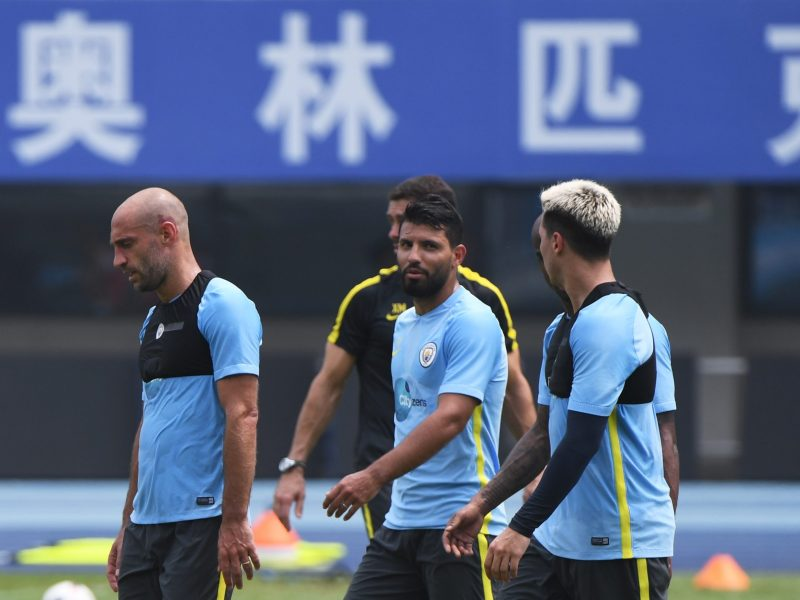 Manchester City players train in Beijing on July 24, 2016. Photo: AFP/Greg Baker