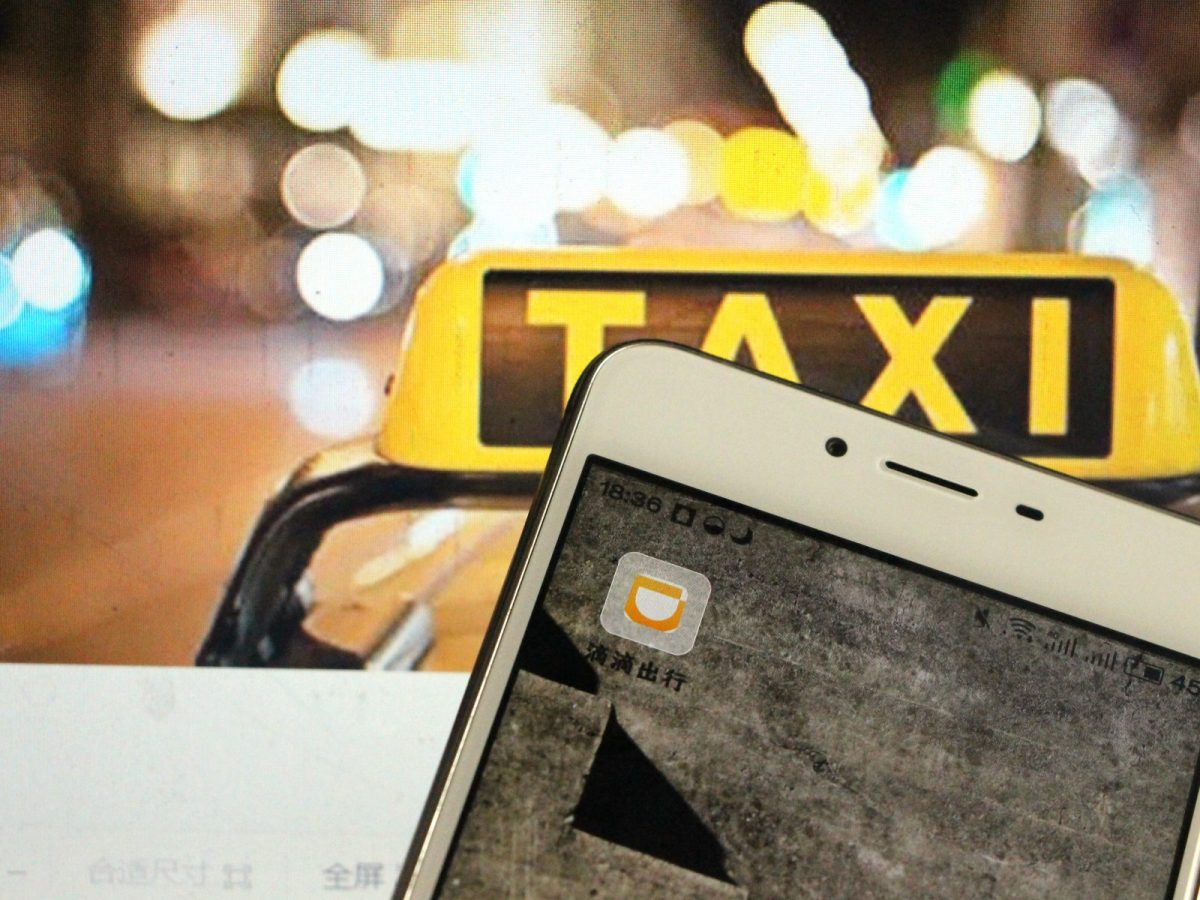 A Chinese mobile-phone user dials the taxi-hailing car-service app DiDi Chuxing. Photo: Xinhua