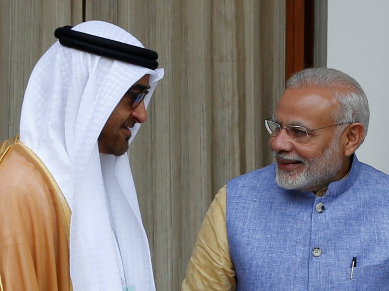 Sheikh Mohammed bin Zayed al-Nahyan, Crown Prince of Abu Dhabi and UAE's deputy commander-in-chief of the armed forces, talks to India's Prime Minister Narendra Modi. Photo: Reuters/Adnan Abidi