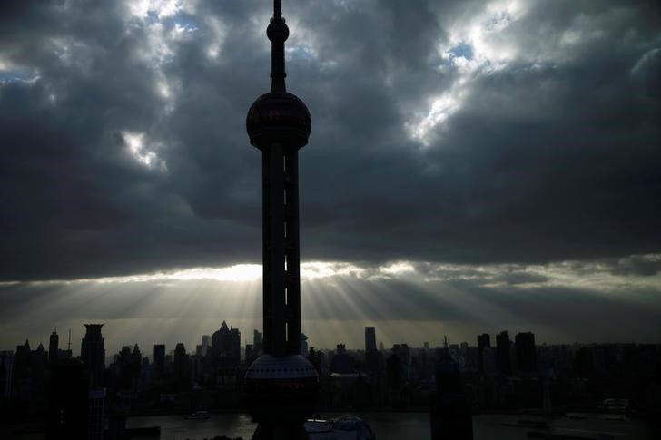 Efforts to crack down on shadow banking are beginning to bite. The Oriental Pearl Tower is seen at the financial district of Pudong in Shanghai. Photo: Reuters/Aly Song