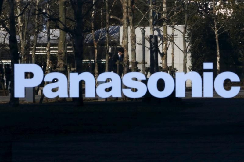 A pedestrian is reflected in a sign at Panasonic Center in Tokyo, Japan, February 3, 2016. Photo: Reuters/Yuya Shino