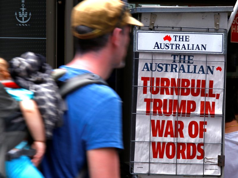 A pedestrian looks at a newspaper headline on US president Donald Trump and Australian Prime Minister Malcolm Turnbull in central Sydney. Photo:    Reuters/David Gray