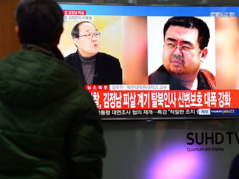 People watch a TV screen broadcasting a news report on the assassination of Kim Jong-nam, the older half brother of the North Korean leader Kim Jong-un. Photo: Lim Se-young / News1 via Reuters