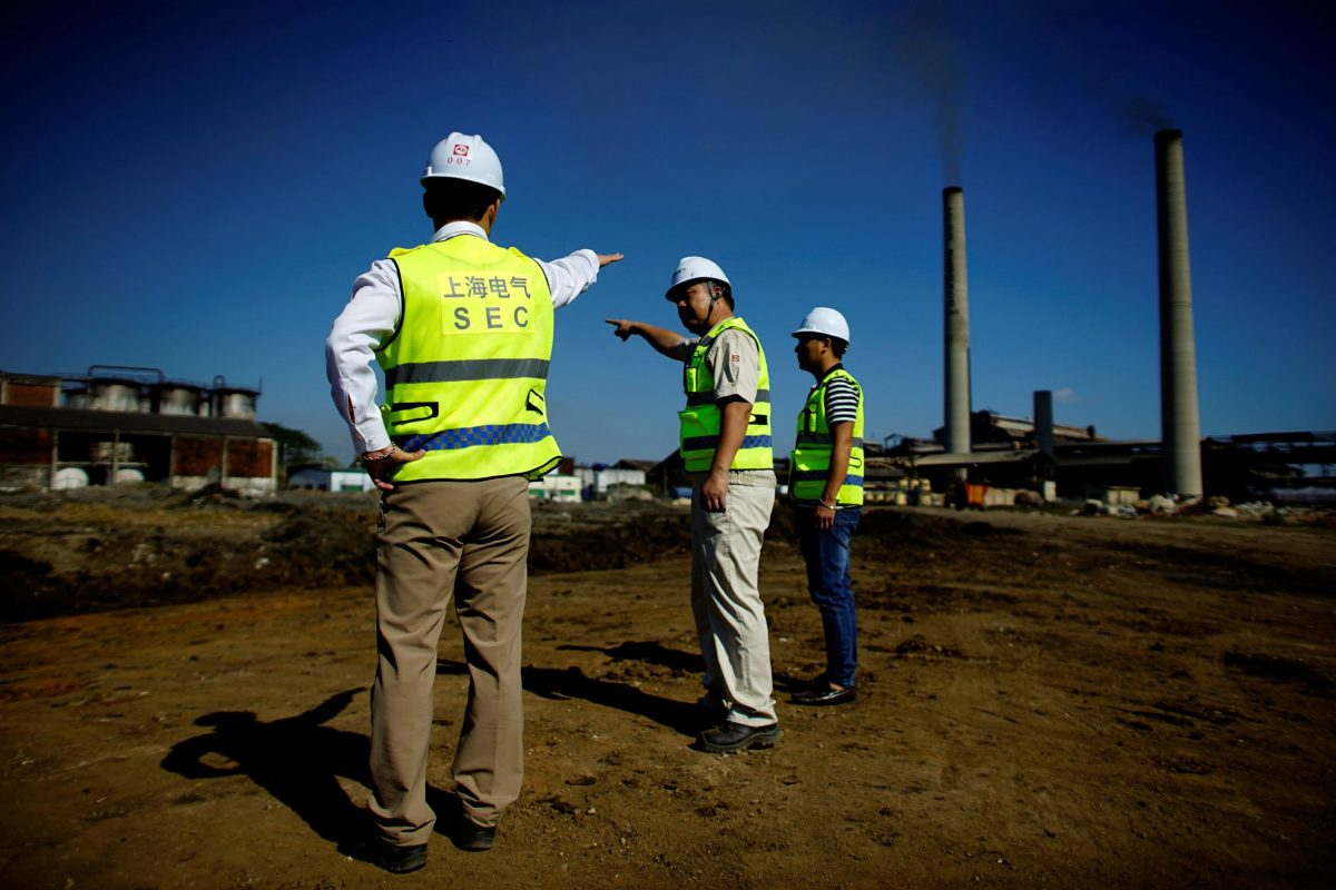 Chinese employees of Shanghai Electric supervise the construction site of a biomass power station in Ciro Redondo, Cuba. Photo: Reuters/Alexandre Meneghini