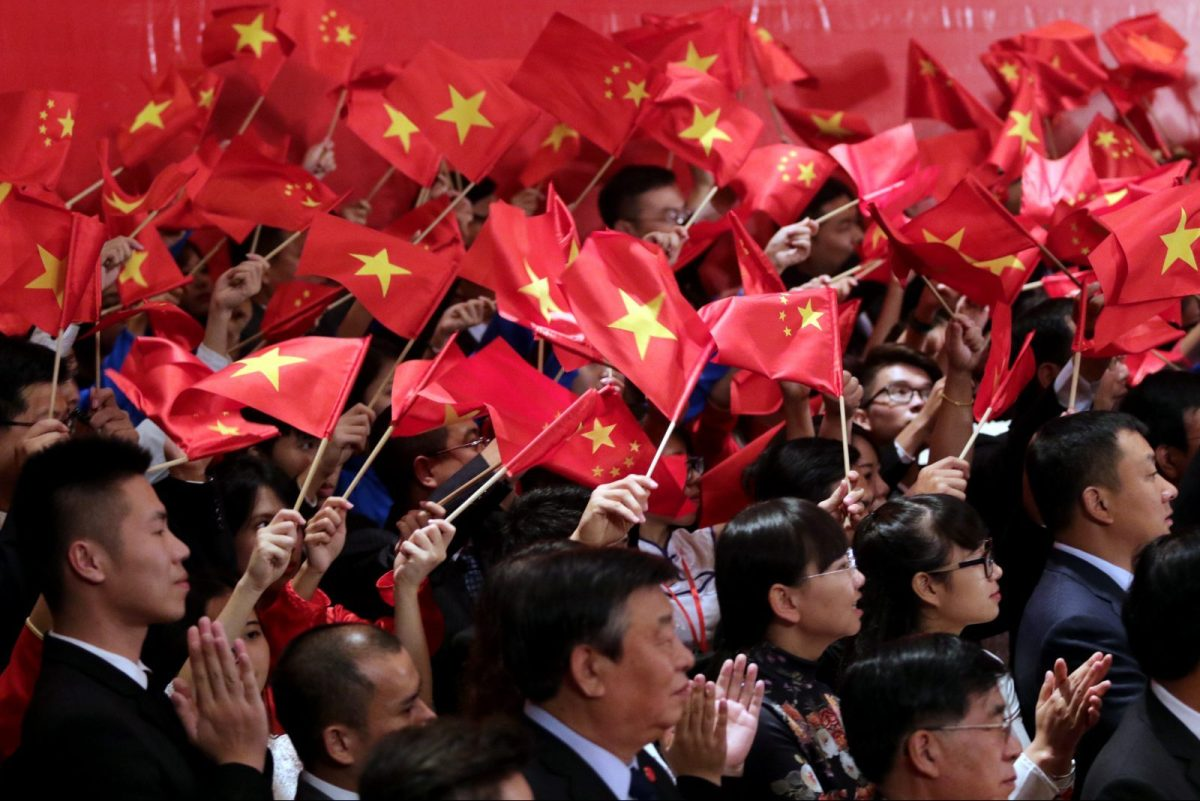 "Vietnamese and Chinese communist youths wave flags to welcome Chinese President Xi Jinping and Vietnamese Communist Party General Secretary Nguyen Phu Trong (both not pictured) at a meeting in Hanoi on November 6, 2015.  Xi said he hoped for a ""higher level"" partnership with Vietnam on a visit that has angered Vietnamese nationalists at a time of bubbling conflict over the South China Sea.    AFP PHOTO / POOL / Na Son Nguyen / AFP PHOTO / POOL / Na Son Nguyen"