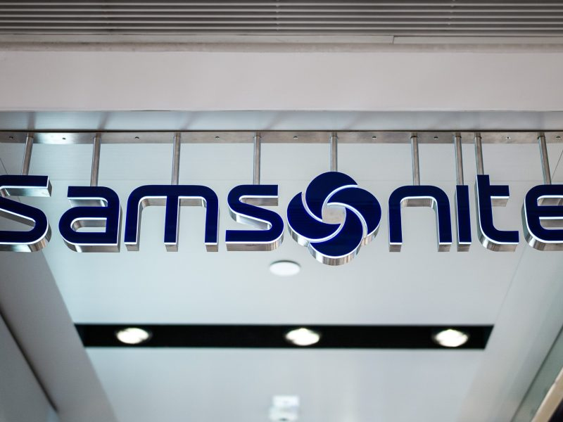 The Samsonite logo is seen at the entrance to a shop in Hong Kong. Photo: AFP/Philippe Lopez