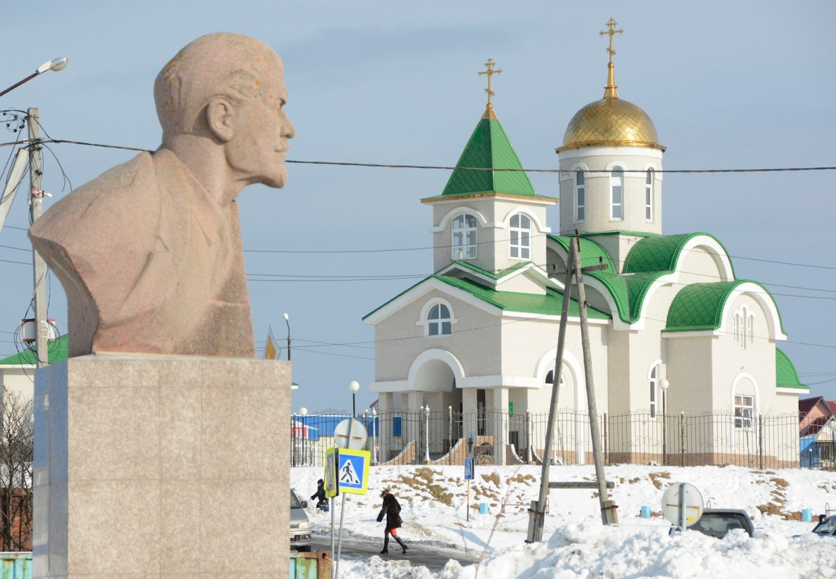 A bust of Vladimir Lenin is seen in front of the Holy Trinity Cathedral in the settlement of Yuzhno-Kurilsk on the Island of Kunashir, one of four islands known as the Southern Kurils in Russia and the Northern Territories in Japan. Photo: Yuri Maltsev, Reuters