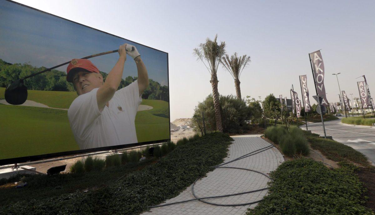 A billboard at the Trump International Golf Club Dubai. Photo: AFP / Karim Sahib