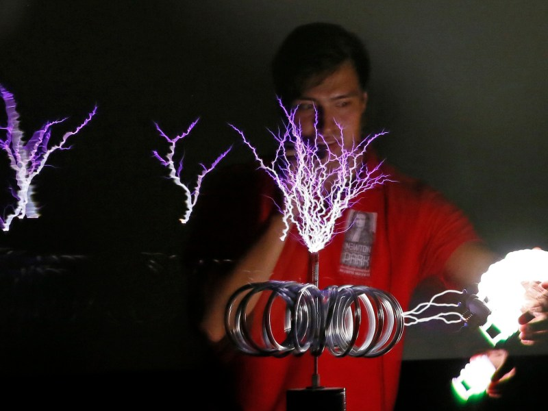 Physicist Fail Gubaidulin, a member of the Newton Park interactive museum of science in Krasnoyarsk, Russia, demonstrates the effect of a Tesla coil.   Photo: Ilya Naymushin, Reuters