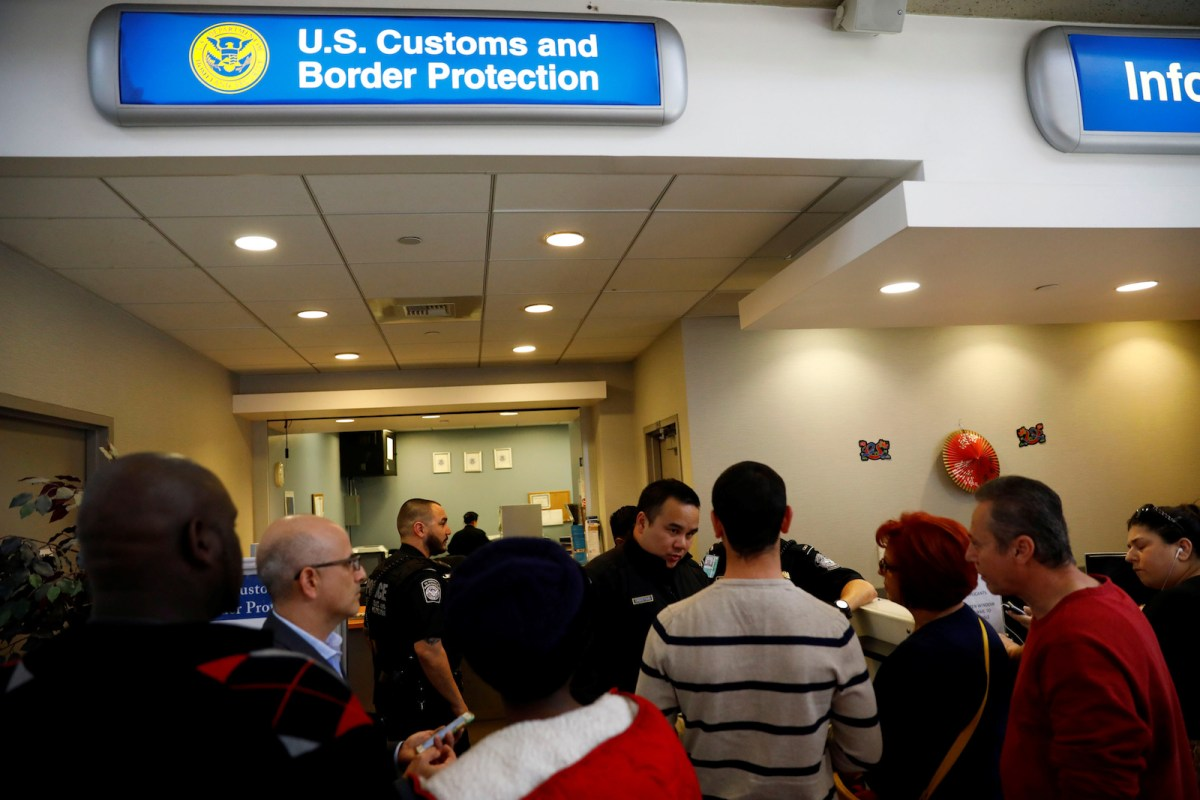 US Customs and Border Protection officers stand ready at Los Angeles International Airport.  Photo: Patrick T Fallon, Reuters