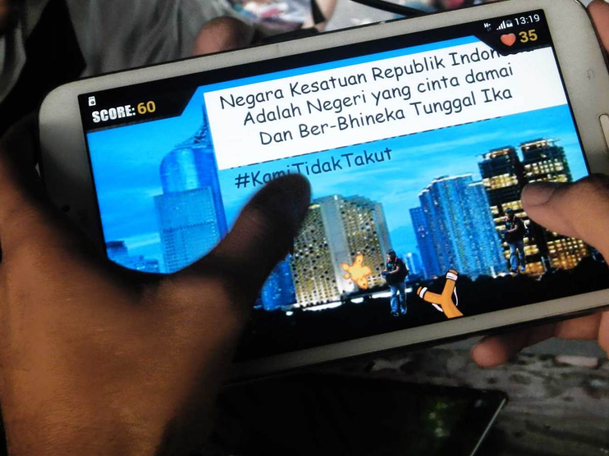 """Indonesian police created  """"Tumpas Teroris"""" (Destroy Terrorists), a video game designed to combat terrorism by educating young people about the impact of terrorism. Indonesian women are becoming more involved in terrorism through the internet. Photo: Bay Ismoyo, AFP"""