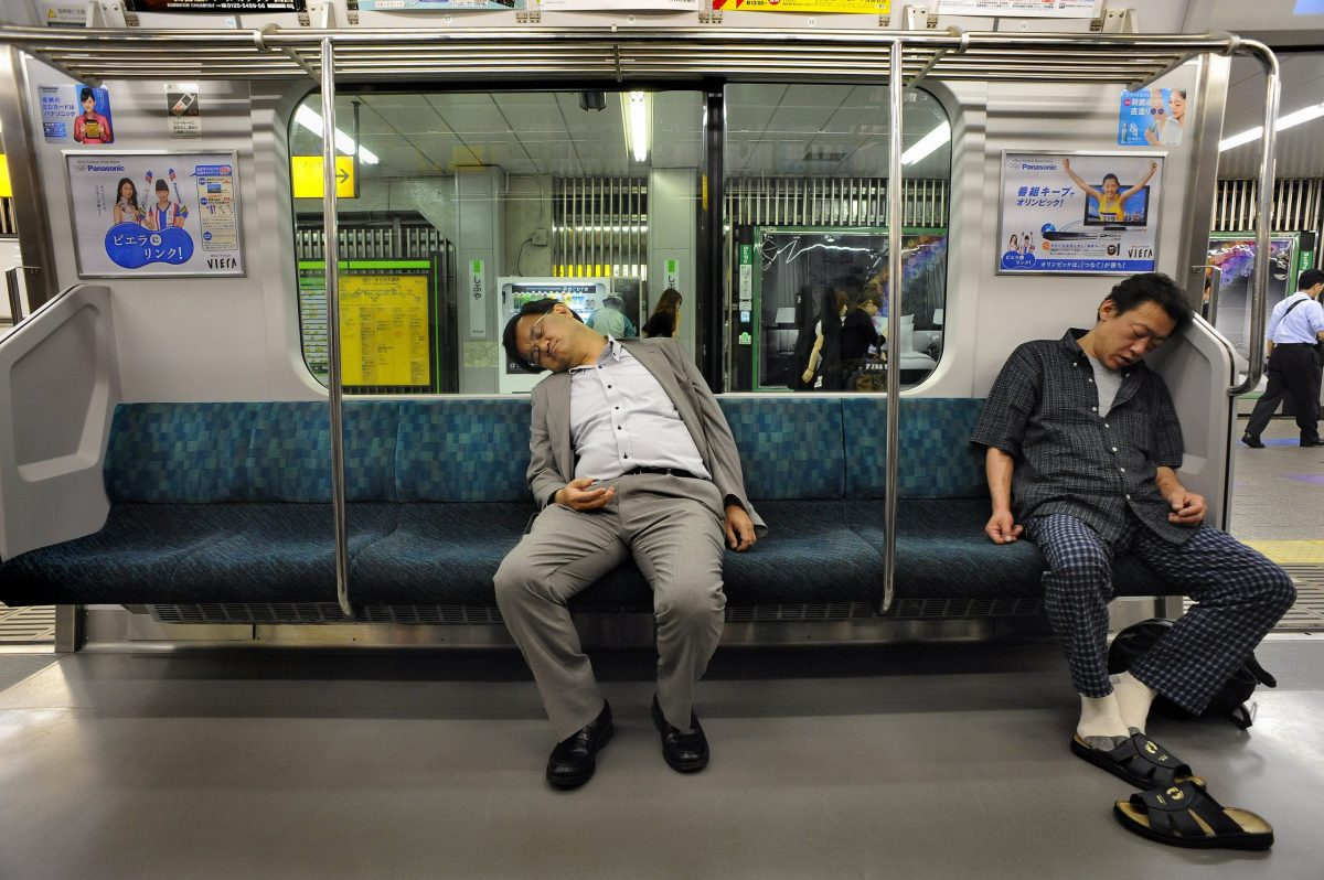 "In Japan the phenomena of over-tired office workers who hardly can keep their eyes open even has a special word: inemuri – ""sleeping while present"". Photo: Agence France-Presse"