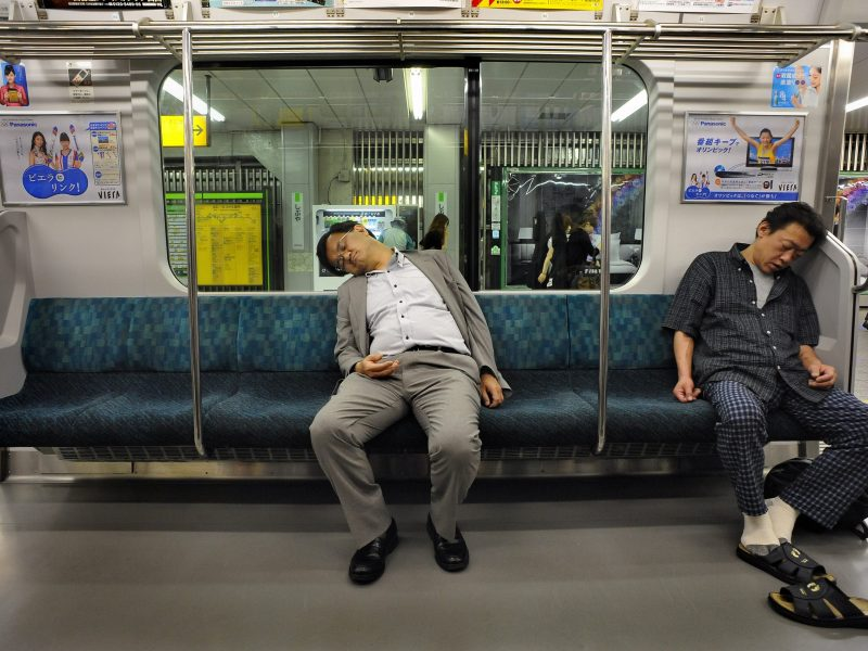 """In Japan the phenomena of over-tired office workers who hardly can keep their eyes open even has a special word: inemuri – """"sleeping while present"""". Photo: Agence France-Presse"""