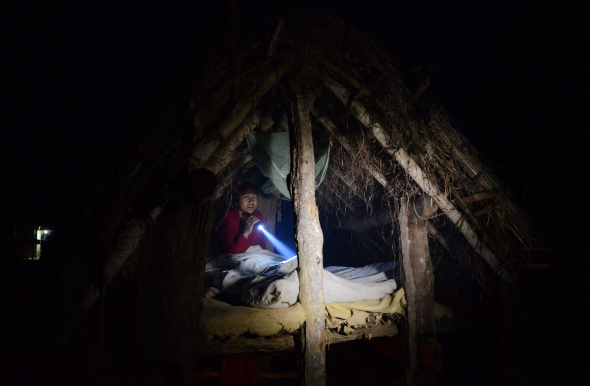 Nepali woman Pabitra Giri prepares to sleep in a Chhaupadi hut during her menstruation period in Surkhet District, 520km west of Kathmandu.Photo: AFP