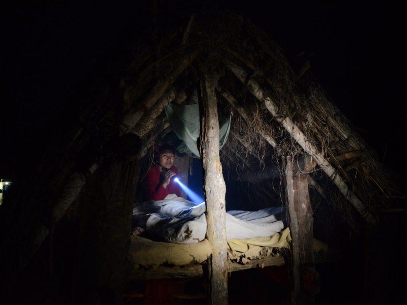 Nepali woman Pabitra Giri prepares to sleep in a Chhaupadi hut during her menstruation period in Surkhet District, 520km west of Kathmandu. Photo: AFP