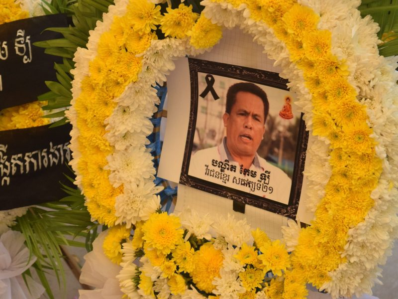 An image of Kem Ley inside a wreath laid in his honor at his funeral at Wat Chas in Phnom Penh. Photo: Daniel de Carteret/ Anadolu Agency