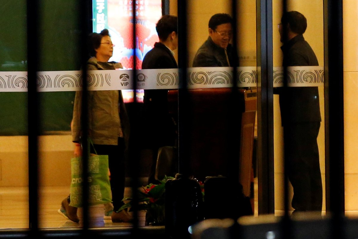 North Korean Ambassador to Malaysia Kang Chol (second right) arrives at the VIP exit of the Beijing Capital International Airport in China.  Photo: Reuters/Tyrone Siu