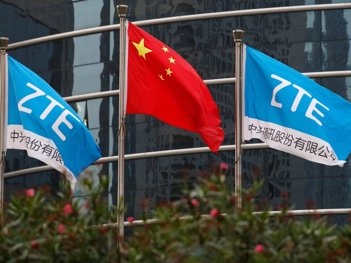 Flags fly at the ZTE offices. Photo: Reuters / Bobby Yip