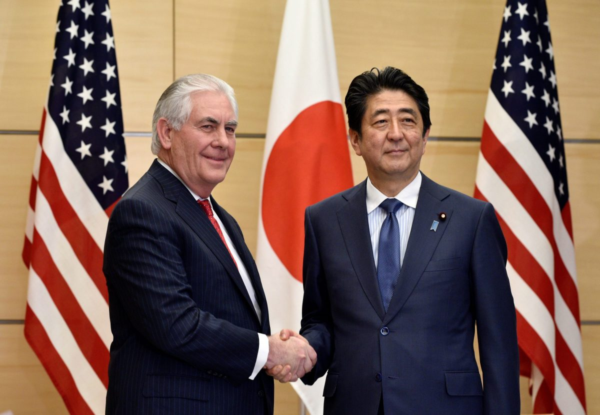 U.S. Secretary of State Rex Tillerson (L) and Japanese Prime Minister Shinzo Abe shake hands before their meeting at Abe's official residence in Tokyo, Japan March 16, 2017.  Reuters/Franck Robichon