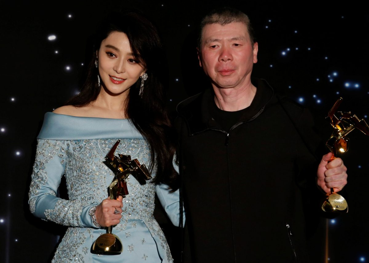Chinese actress Fan Bingbing and director Feng Xiaogang celebrate with their Best Actress and Best Film awards at the Asian Film Awards. Photo: Reuters/Bobby Yip