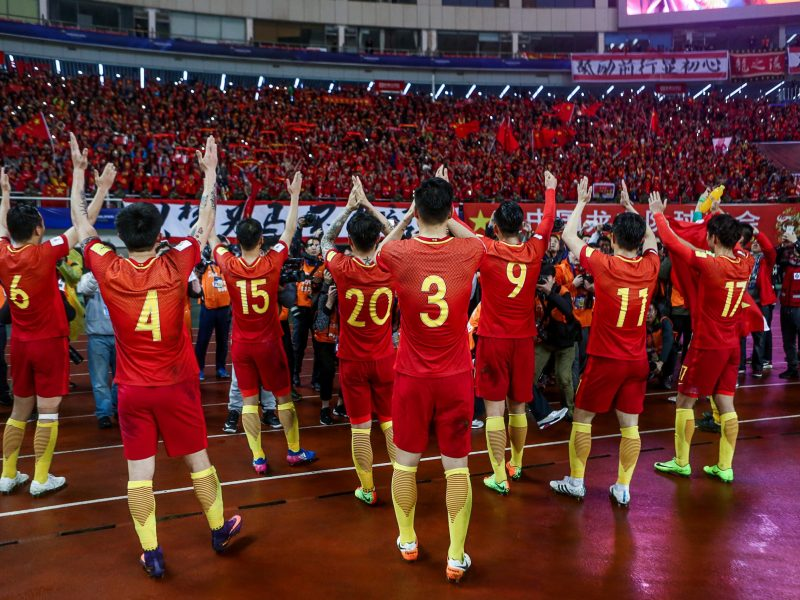 Team China celebrates after winning against South Korea in a 2018 World Cup Qualifier in Changsha, China. Photo: Reuters