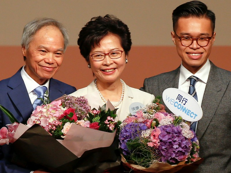 Carrie Lam is congratulated by her husband and son after she won the election for Hong Kong's next Chief Executive in Hong Kong, China March 26, 2017.   Reuters/Bobby Yip