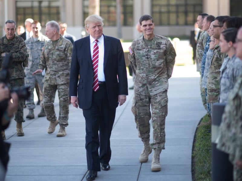 President Donald Trump and Gen. Joseph Votel, commander of U.S. Central Command Commander, meet with service members at MacDill, AFB, FL, Feb. 6, 2017.   Photo:  US government CC 2.0