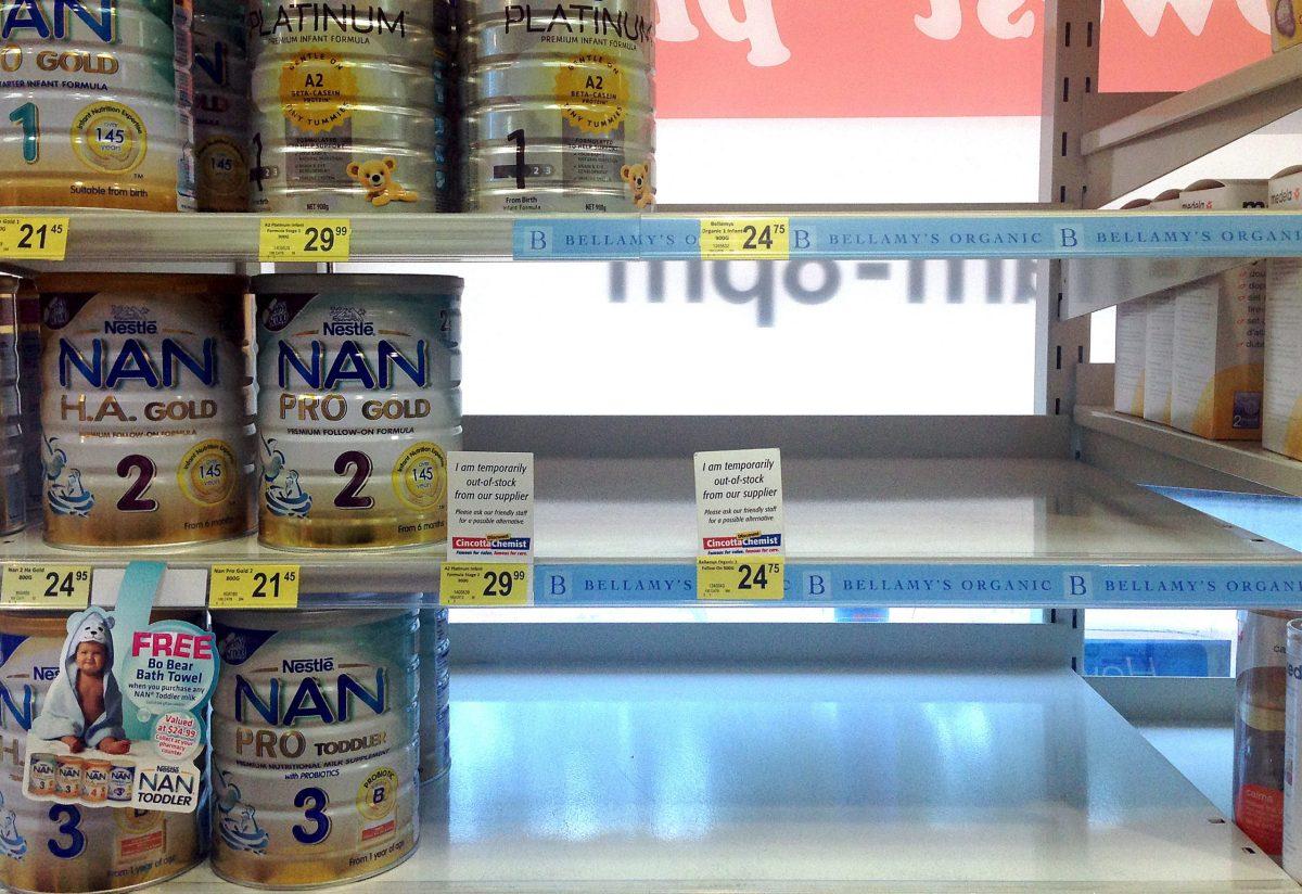 Empty shelves display notices regarding stock for Belamy's organic toddler milk formula at a shop in Sydney, Australia. Phtoto: Reuters, David Gray