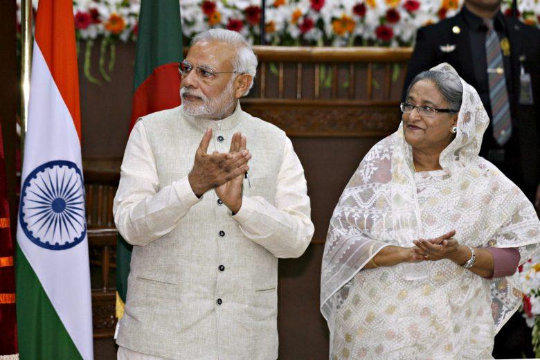 India's Prime Minister Narendra Modi (L) and his Bangladeshi counterpart Sheikh Hasina. Photo: Reuters, Rafiqur Rahman