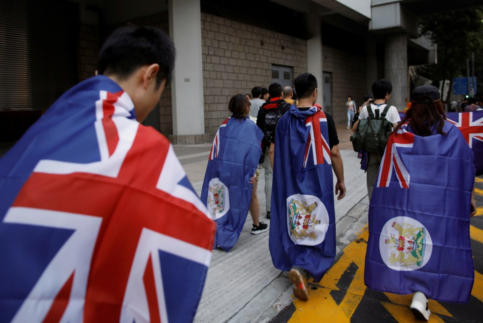 Demonstrators sport colonial Hong Kong flags during a protest against what they call Beijing's interference in local politics and the rule of law. Photo: Tyrone Siu, Reuters