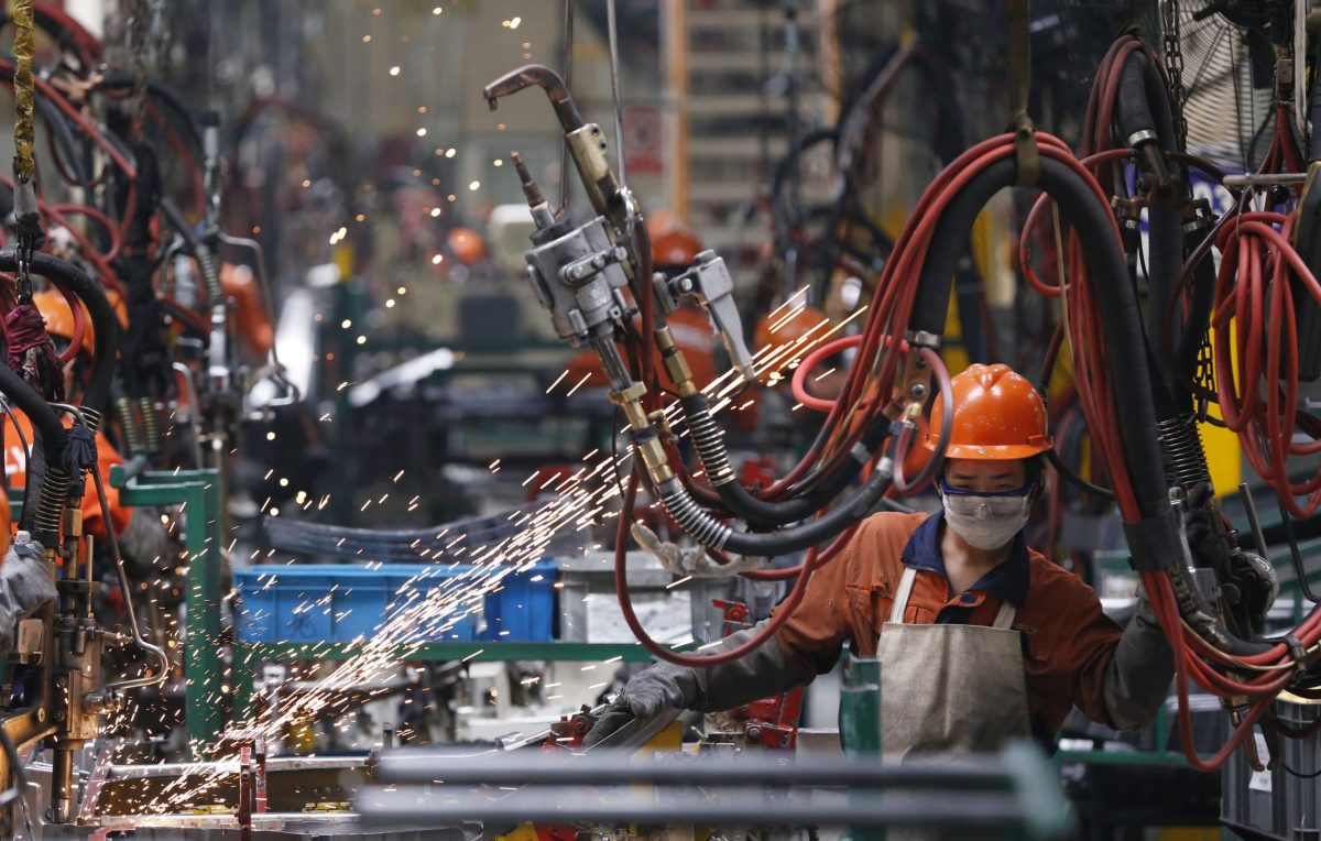 An employee works at a production line inside a Geely factory in Ningbo, Zhejiang province. Photo: Reuters