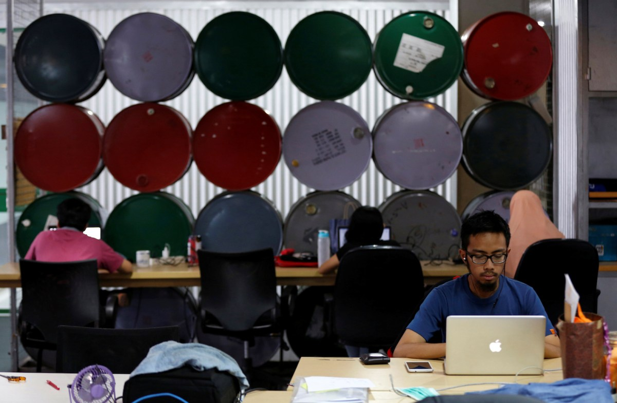 Employees work at Mediatrac, a data analytics start-up in Jakarta. Photo: Darren Whiteside, Reuters