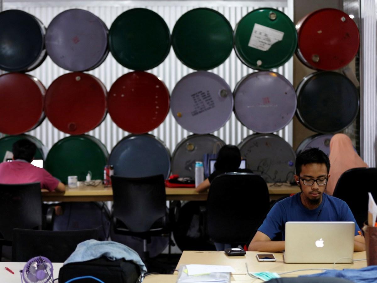 Employees work at Mediatrac, a data analytics start-up in Jakarta. Photo: Darren Whiteside, Reuters
