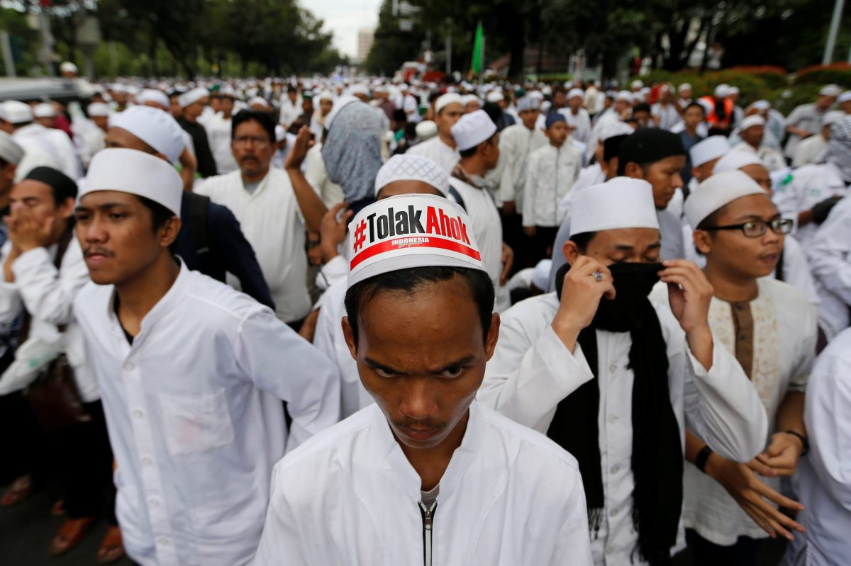 """Hardline Muslim groups protest against Jakarta's incumbent governor Basuki Purnama (Ahok), an ethnic Chinese Christian running for re-election. The sign reads: """"Reject Ahok."""" Photo: Reuters/Beawiharta"""