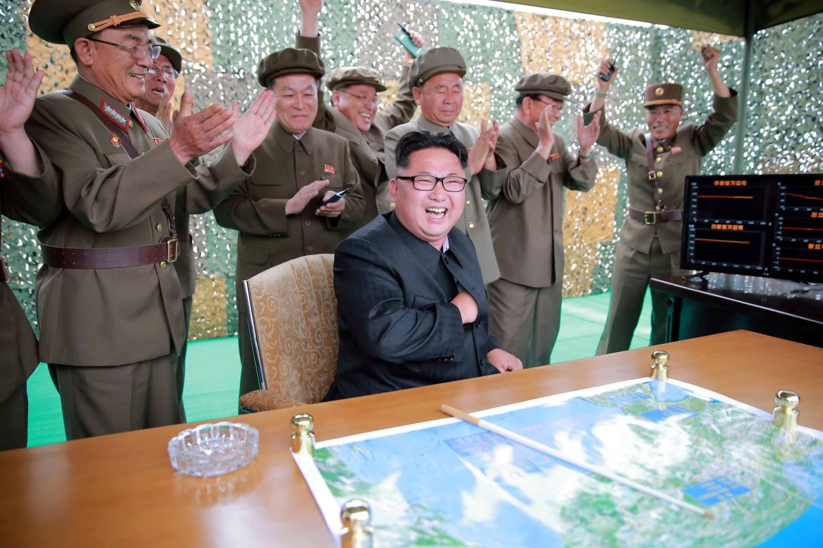 Shall I do that again? North Korean leader Kim Jong-un reacts during a test launch. Photo: Reuters